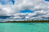 seascape with white clouds in blue sky