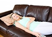 Unstressed Woman Lies On Sofa And Watches Tv