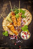 image of souvlaki  - Chicken skewers and vegetable dipping sauce - JPG