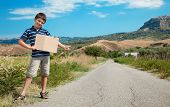 little boy hitchhiking along the street, portrait