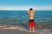 a little boy looks the sea alone, portrait