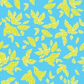 Summer leaves on blue background. Seamless pattern