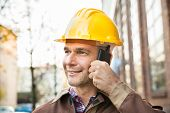 Builder Wearing Hardhat Talking On Walkie Talkie