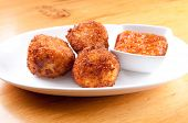 Gooey Macaroni And Cheese Balls And Marinara Sauce