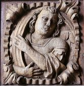 stock photo of minos  - Wooden engraving at the main entrance door of the Cathedral of Tui Galicia Spain - JPG