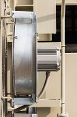picture of fin  - Side view of electrical cooling fan attached to the radiator fin of the transformer - JPG
