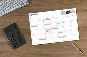 Calendar Tax Due And Calculator On Wooden Table