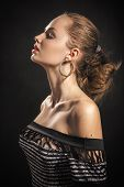 foto of aroused  - pretty aroused young woman profile on black background - JPG