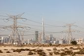 image of dubai  - Skyline of Dubai with power lines in foreground - JPG