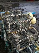 stock photo of lobster boat  - Lobster pots stacked in the harbour - JPG