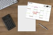 Calendar Kick-off Blank Sheet And Calculator On Wooden Table