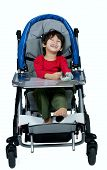 image of biracial  - Three year old biracial disabled boy in medical stroller happy and smiling - JPG