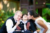 foto of biracial  - Biracial bride kissing her little brother on her wedding day - JPG
