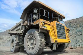pic of heavy  - Heavy mining truck on the iron ore opencast mining quarry - JPG