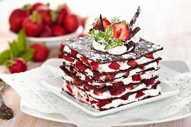 pic of peppermint  - Chocolate dessert with strawberries whipped cream and mint - JPG
