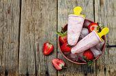 stock photo of strawberry  - strawberry ice cream and strawberry on a dark wood background - JPG