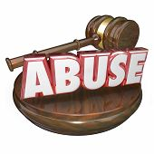 picture of abused  - Abuse word in red 3d letters beside a wooden gavel to illustrate a criminal court case sentence or verdict against a defendant accused of sexually - JPG