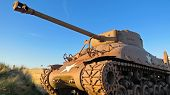 Постер, плакат: American WW2 Sherman tank during sunset