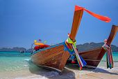 stock photo of phi phi  - Longtail boats landing in Phi - JPG