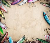 stock photo of spinner  - Frame with spinner lures and fishing bait - JPG