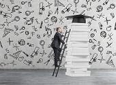 picture of prize  - A student is climbing up to get university degree - JPG