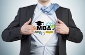 picture of degree  - Successful young student is tearing the shirt - JPG