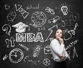 stock photo of degree  - A lady is pondering over the business degree - JPG