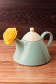 picture of blue rose  - Light blue teapot with flower roses on a wooden background