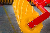 stock photo of tractor-trailer  - Close up of new yellow agricultural connection machine for tractor  - JPG