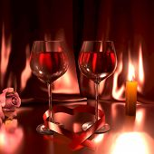 stock photo of libido  - Romantic scene with two glasses of good red wine a rose and a lit candle - JPG