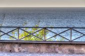 pic of balustrade  - metal balustrade by the shore - JPG