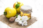 foto of apple blossom  - Fresh honey with apples and apple blossom on a wooden background - JPG