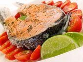 stock photo of salmon steak  - Salmon steak with cherry tomatoes and cream - JPG