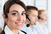 picture of employee  - Three call center service operators at work - JPG