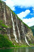 stock photo of fjord  - Geiranger Fjord (Norge) and waterfall Seven sisters ** Note: Soft Focus at 100%, best at smaller sizes - JPG