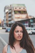 foto of curvy  - Beautiful young curvy girl in tank top posing in an urban context - JPG