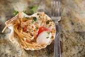 stock photo of scallops  - First dish with spaghetti integral to scallops and parsley - JPG