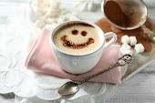 stock photo of latte  - Cup of latte coffee art on wooden table - JPG