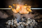 image of briquette  - Cooking rotisserie chicken on the grill with Charcoal and Briquettes in the professional steak house or barbecue restaurant - JPG