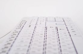 picture of backspace  - White computer keyboard with wire on isolated white background - JPG