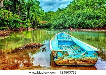 Old boat in tropical river, perfect place for fishing, exotic summer adventure, amazing nature of Na