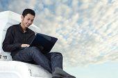 businessman using notebook outdoors