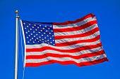 United States of America flag flying on flagpole.
