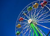 stock photo of ferris-wheel  - View of a still ferris wheel on a sunny day at a carnival - JPG