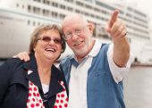 picture of cruise ship  - Senior Couple On Shore in Front of Cruise Ship While on Vacation - JPG
