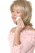 Woman Using Makeup Applicator