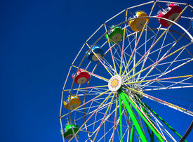 image of ferris-wheel  - View of a still ferris wheel on a sunny day at a carnival - JPG
