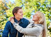 Spring couple walking park. Summer friends walk outdoor. First date of two young people in good weat poster