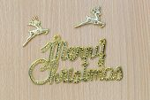 Gold Merry Christmas Text On A Brown Wooden Floor And Have Copy Space To Input Ideas Of Your Work. poster