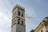 stock photo of assis  - the basilica tower in Assis just after an event plastic doves hang from the tower - JPG